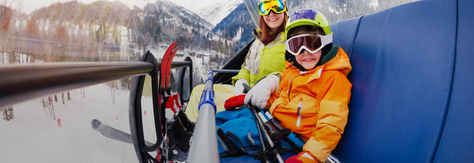 mother and son on ski lift